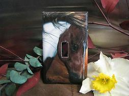 brown horse quarter walikng light switch wall