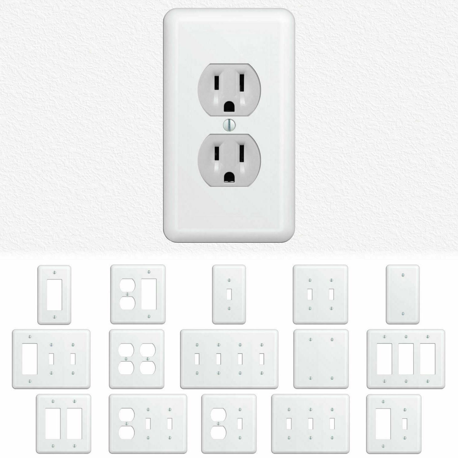 white metal light switch wall plate outlet